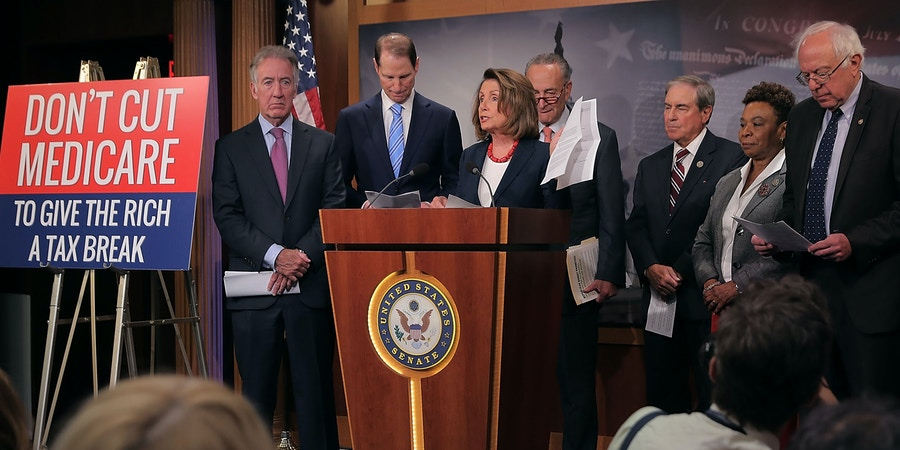WASHINGTON, DC - OCTOBER 04:  (L-R) Rep. Richard Neal (D-MA), Senate Finance Committee ranking member Sen. Ron Wyden (D-OR), House Minority Leader Nancy Pelosi (D-CA), Senate Minority Leader Chuck Schumer (D-NY), House Budget Committee ranking member Rep. John Yarmuth (D-KY), Rep. Barbara Lee (D-CA) and Senate Budget Committee ranking member Sen. Bernie Sanders (I-VT) hold a news conference critical of the Republican tax and budget plan at the U.S. Capitol October 4, 2017 in Washington, DC. The Congressional Democrats called on President Donald Trump to keep his campaign promises to not cut entitlement programs like Social Security and Medicaid.  (Photo by Chip Somodevilla/Getty Images)
