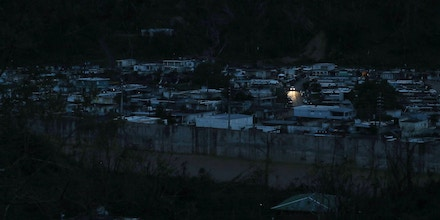 UTUADO, PUERTO RICO - OCTOBER 06:  A car passes among dark homes as people wait for electricity to be restored after Hurricane Maria passed through on October 6, 2017 in Utuado, Puerto Rico.  Puerto Rico experienced widespread damage including most of the electrical, gas and water grid as well as agriculture after Hurricane Maria, a category 4 hurricane, passed through.  (Photo by Joe Raedle/Getty Images)