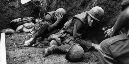 US troops take cover from the Vietcong in a trench on Hill Timothy, during the Vietnam War.   (Photo by Terry Fincher/Getty Images)