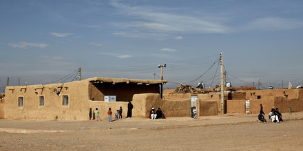 A general view shows the Shahid Nasseri refugee camp in Taraz Nahid village near the city of Saveh, some 130 kms southwest of the capital Tehran, on February 8, 2015. Some 5000 Afghan refugees live at the camp which is run by the Iranian Bureau for Aliens and Foreign Immigrants' Affairs (BAFIA), the World Food Program (WFP) and UNHCR. According to the United Nations High Commissioner for Refugees (UNHCR), there are 950,000 registered Afghan residents in Iran -- some of whom have never even set foot in their homeland -- but interior ministry estimates around three million Afghans living in the Islamic republic. AFP PHOTO / BEHROUZ MEHRI        (Photo credit should read BEHROUZ MEHRI/AFP/Getty Images)