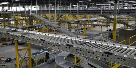 SACRAMENTO, CA - AUGUST 10:  A view of a conveyor belt system that is under construction at a new Amazon fulfillment center on August 10, 2017 in Sacramento, California. Amazon is preparing to open a new 855,000-square-foot warehouse, the tenth in California, by early October and is expected to hire nearly 1,500 people.  (Photo by Justin Sullivan/Getty Images)