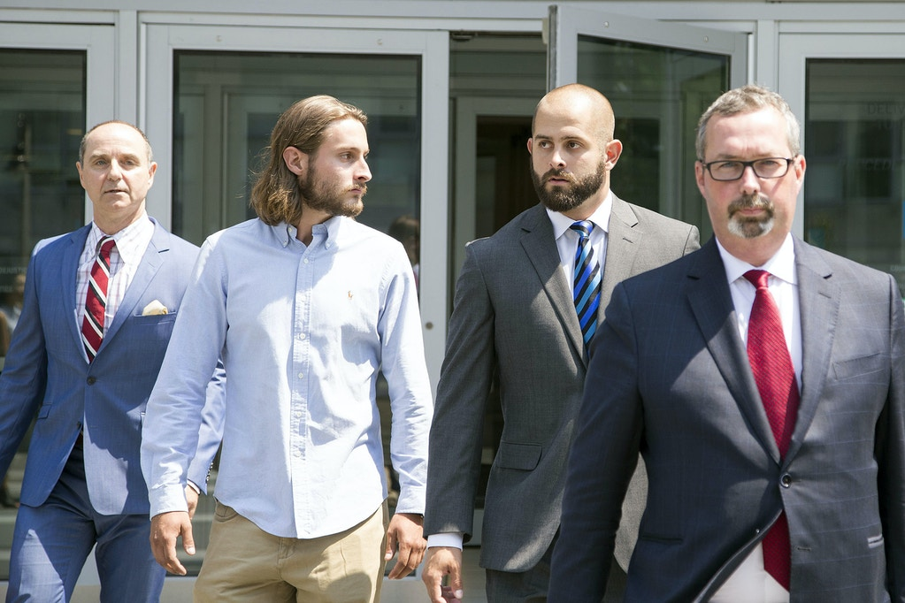 OSHAWA, ON - AUGUST 2  -    (l-r) David Butt, lawyer for Christian Theriault, Christian Theriault, Const. Michael Theriault and his lawyer Michael Lacy. OSHAWA, ON - AUGUST 2  -   Const. Michael Theriault (right) and his brother, Christian Theriault leave Durham Region Courthouse in Oshawa, following and appearance in relation to the beating of Dafonte Miller on August 2, 2017.They are charged with public mischief in addition to aggravated assault and assault with a weapon in connection with the Dec. 28 beating of Dafonte Miller in Whitby.        (Carlos Osorio/Toronto Star via Getty Images)