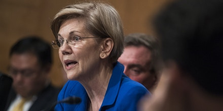 UNITED STATES - OCTOBER 04: Sen. Elizabeth Warren, D-Mass., questions Richard Smith, CEO of Equifax, during a Senate Banking, Housing and Urban Affairs Committee hearing in Dirksen on the company's security breach on October 4, 2017. (Photo By Tom Williams/CQ Roll Call) (CQ Roll Call via AP Images)