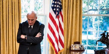 White House Chief of Staff John Kelly waits while Governor of Puerto Rico Ricardo Rossello and US President Donald Trump make statement to the press before a meeting  in the Oval Office of the White House October 19, 2017 in Washington, DC. / AFP PHOTO / Brendan Smialowski        (Photo credit should read BRENDAN SMIALOWSKI/AFP/Getty Images)