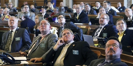 Kansas House members watched the vote board Monday, April 3, 2017, as the House sustained Gov. Sam Brownback's veto of Medicaid expansion. The House fell three votes short of the two-thirds threshold for overriding him voting 81-44. (Thad Allton/Topeka Capital-Journal via AP)