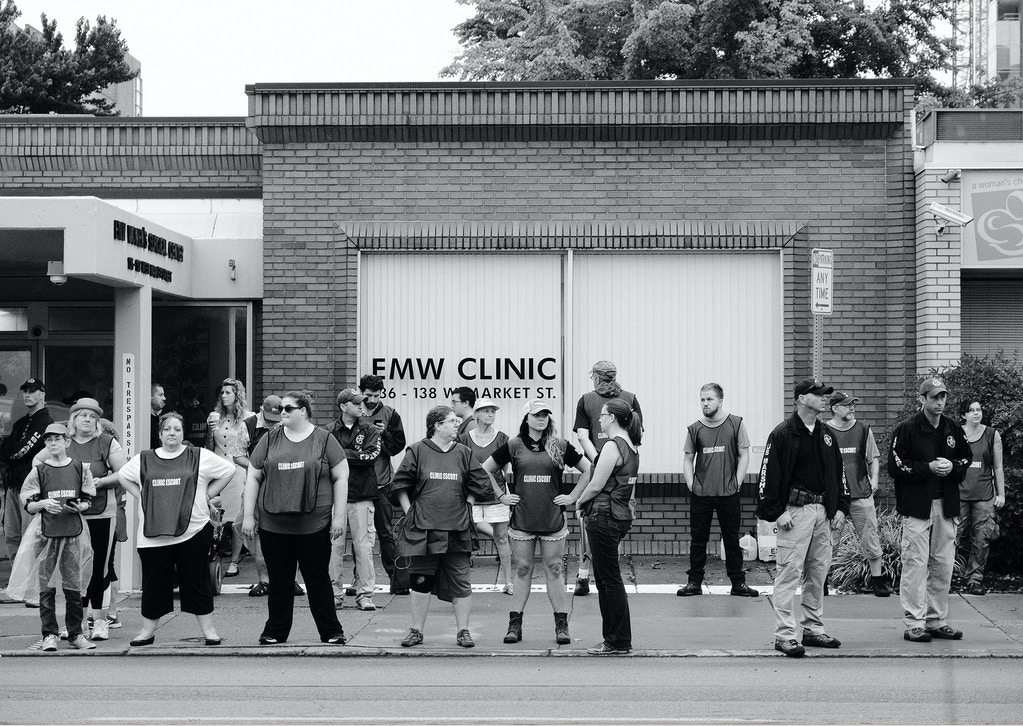 Clinic escorts gather outside EMW Clinic, preparing for another day of intense protests by Operation Save America.