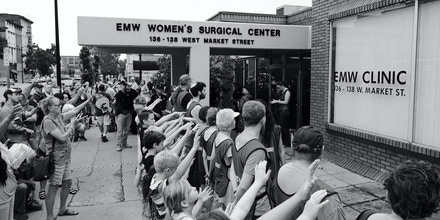 Operation Save America brought a large group of children to the protest again EMW Women's Clinic, at one point lining them up and instructing them to pray at the escorts and clinic. Two adult men exhorted the children into more fervent prayers after positioning them, recording the event with a GoPro camera. The clinic escorts stood professionally and stoically throughout the ordeal.