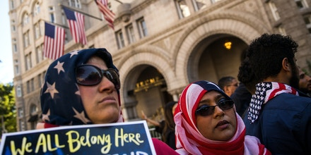 WASHINGTON, DC - OCTOBER 18: Following a rally in Lafayette Park, activists arrive at Trump International Hotel during a protest against the Trump administration's proposed travel ban, October 18, 2017 in Washington, DC. Early Wednesday morning, a federal judge in Maryland granted a motion for a preliminary injunction on the administration's travel ban. This is the Trump administration's third attempt to restrict entry into the United States for citizens from mostly Muslim-majority countries. The Department of Justice said it plans to appeal and the White House issued a statement calling the judge's decision 'dangerously flawed.' (Photo by Drew Angerer/Getty Images)