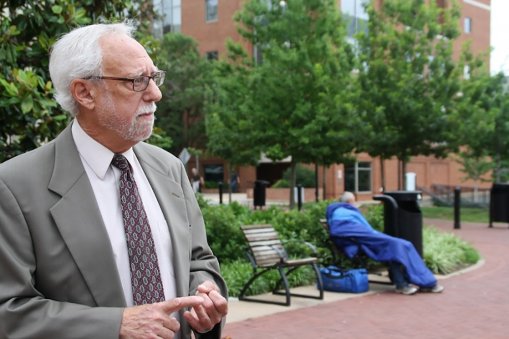 Attorney Jeffrey Fogel represents five homeless men in a suit in Charlottesville, Virginia, in June 2011