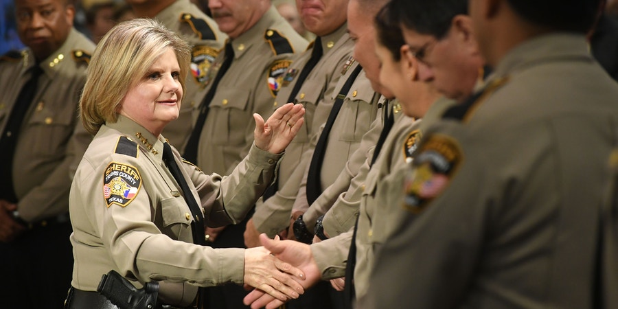 Sally Hernandez congratulates her command staff after swearing them in at a Swearing-In Ceremony on January 4, 2017
