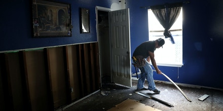 HOUSTON, TX - SEPTEMBER 05:  A contractor removes moldy materials from a flood damaged home on September 5, 2017 in Houston, Texas. Over a week after Hurricane Harvey hit Southern Texas, residents are beginning the long process of recovering from the storm.  (Photo by Justin Sullivan/Getty Images)