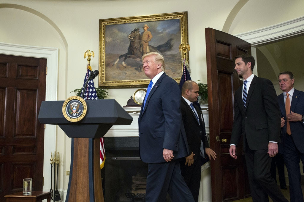 "WASHINGTON, DC - AUGUST 2: (AFP OUT) U.S. President Donald Trump arrives before making an announcement on the introduction of the Reforming American Immigration for a Strong Economy (RAISE) Act with Sen. Tom Cotton (R-AR) and Sen. David Perdue (R-GA) in the Roosevelt Room at the White House on August 2, 2017 in Washington, DC. The act aims to overhaul U.S. immigration by moving towards a ""merit-based"" system. (Photo by Zach Gibson - Pool/Getty Images)"
