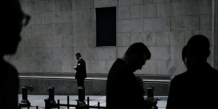 NEW YORK, NY - JULY 25:  A trader stands outside of the New York Stock Exchange (NYSE) on July 25, 2017 in New York City. The Dow Jones industrial average rose over 100 points as corporate profits came in better than many analysts had expected.  (Photo by Spencer Platt/Getty Images)