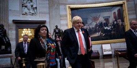 Britain's Foreign Secretary Boris Johnson walks past paintings of the US Declaration of Independence from the British Empire and the surrender of General Burgoyne while meeting with US lawmakers on Capitol Hill November 8, 2017 in Washington, DC. / AFP PHOTO / Brendan Smialowski        (Photo credit should read BRENDAN SMIALOWSKI/AFP/Getty Images)