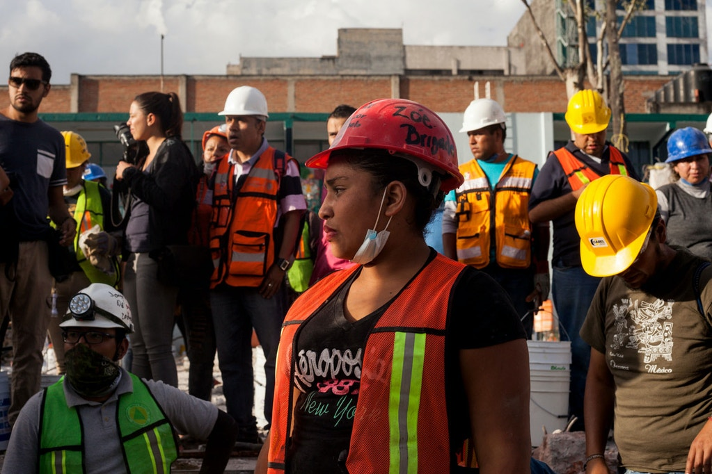 Adriana and other volunteer rescue workers hold a moment of silence for all those who died in the collapsed building.