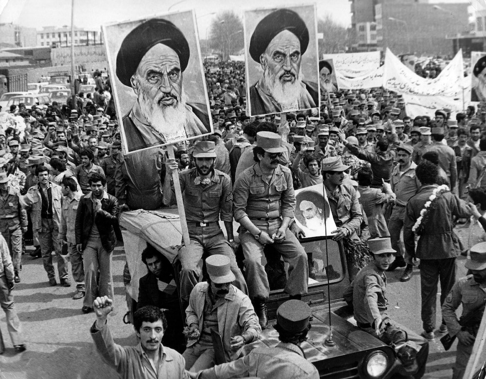 The Iranian Islamic Republic Army demonstrates in solidarity with people in the street during the Iranian revolution. They are carrying posters of the Ayatollah Khomeini, the Iranian religious and political leader.   (Photo by Keystone/Getty Images)