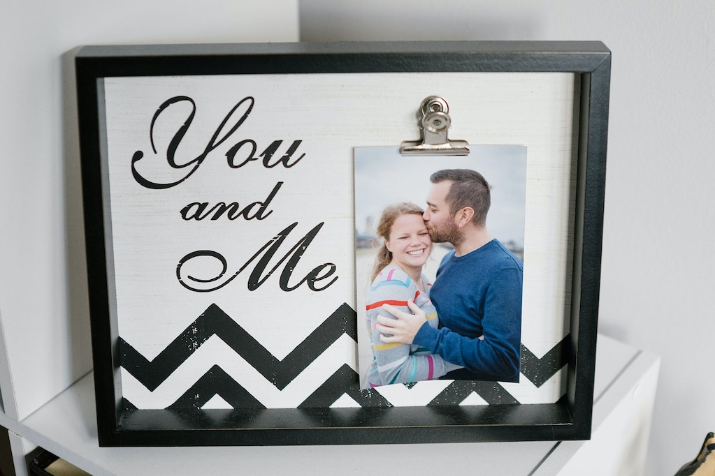 A framed engagement photo of Alicia Baker and her husband, Josh, in their home in Indianapolis.