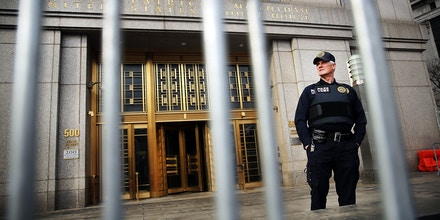 NEW YORK, NY - APRIL 14: A security officer stands outside of U.S. Federal Court House on the morning the court begins jury selection for the Abu Hamza terrorism trial on April 14, 2014 in New York City. Hamza, a disabled Egyptian Islamic preacher who was extradited from Britain following charges he conspired to support al-Qaida, is being charged for trying to create a terrorist training camp in Oregon 15 years ago. (Photo by Spencer Platt/Getty Images)