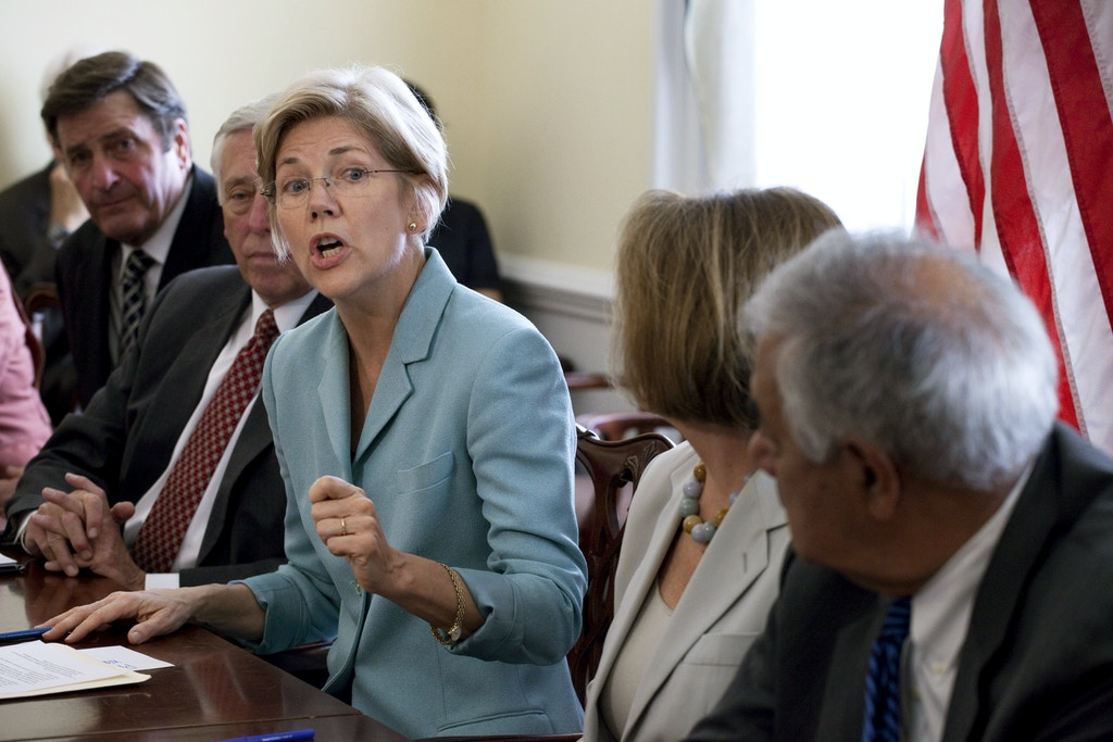 Elizabeth Warren, center, Special Asst. to the Treasury Secretary on the Consumer Financial Protection Bureau, speaks during a photo opportunity on the occasion of the anniversary of the Dodd-Frank Bill as Rep. John Garamendi, D-Calif., left, House Minority Whip Steny Hoyer, D-Md., 2nd left, House Minority Leader  Nancy Pelosi, 2nd right, and Rep. Barney Frank, D-Mass. right, listen  on Capitol Hill in Washington on Wednesday, July 20, 2011.(AP Photo/Harry Hamburg)