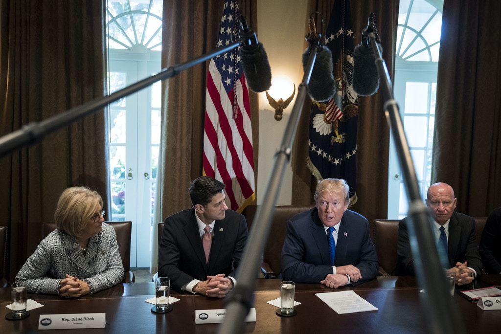 WASHINGTON, DC - NOVEMBER 02: Flanked by Speaker of the House Paul Ryan and House Ways and Means Committee chairman Rep. Kevin Brady (R-TX), President Donald Trump speaks about tax reform legislation during a meeting with members of the House Ways and Means Committee in the Cabinet Room at the White House, November 2, 2017 in Washington, DC. Also pictured at left is Rep. Diane Black (R-TN) On Thursday, Republican lawmakers unveiled their plans for a massive rewrite of the U.S. tax code. (Drew Angerer/Getty Images)