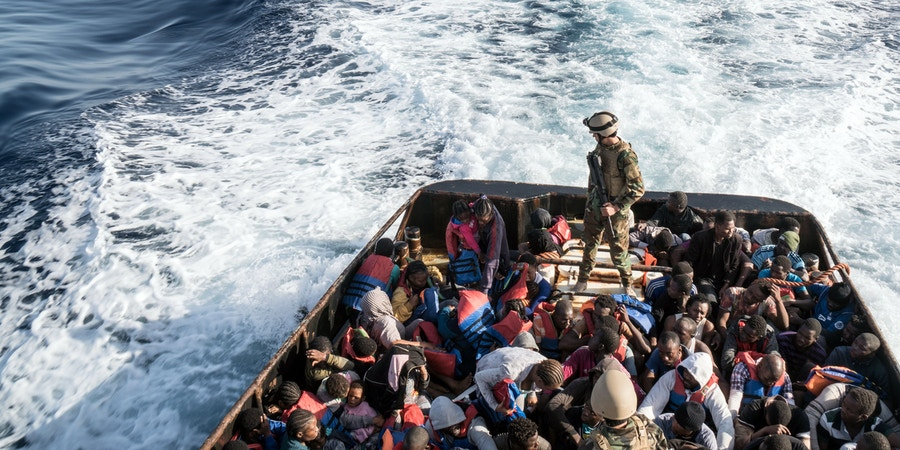 A Libyan coast guardsman stands on a boat during the rescue of 147 illegal immigrants attempting to reach Europe off the coastal town of Zawiyah, 45 kilometres west of the capital Tripoli, on June 27, 2017.More than 8,000 migrants have been rescued in waters off Libya during the past 48 hours in difficult weather conditions, Italy's coastguard said on June 27, 2017. / AFP PHOTO / Taha JAWASHI (Photo credit should read TAHA JAWASHI/AFP/Getty Images)