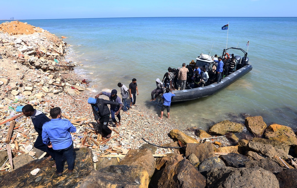 TOPSHOT - Illegal migrants from Africa arrive on shore after being rescued by Libyan coast guards rescued at sea, off the coastal town of Tajoura, 15 kilometres east of the capital Tripoli on May 23, 2017. / AFP PHOTO / MAHMUD TURKIA        (Photo credit should read MAHMUD TURKIA/AFP/Getty Images)