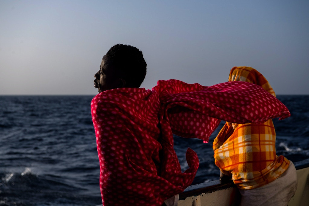 AT SEA, AT SEA - FEBRUARY 19:  A migrant from Togo is seen on deck of the Spanish NGO Proactiva Open Arms rescue vessel Golfo Azzurro sailing towards the Italian port of Pozzallo after being rescued off Libyan coast north of Sabratha, Libya on February 19, 2017 at Sea. 466 migrants were rescued in high seas last Friday by the Italian Coast Guard and the Spanish NGO Proactiva Open Arms rescue vessel Golfo Azzurro. Proactiva Open Arms are a Spanish charity based out of Malta who provide search and rescue assistance to refugees and migrants in distress at sea. They patrol the SAR and Rescue Zone off the coast of Libya running rescue missions for the hundreds of migrants who continue to make perilous journey across the Mediterranean in hope of reaching the European mainland.  (Photo by David Ramos/Getty Images)