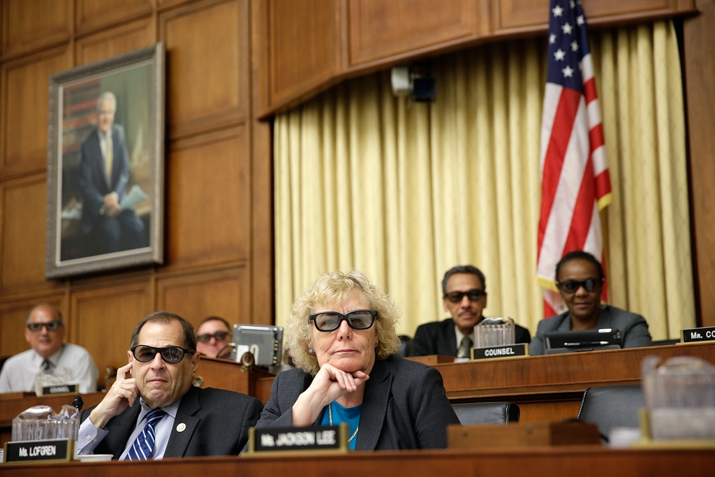 "WASHINGTON, DC - JULY 25:  Rep. Zoe Lofgren (D-CA) (3rd R) and Rep. Jerrold Nadler (D-NY) (2nd L) join with other members of the House Courts, Intellectual Property and the Internet Subcommittee in wearing 3D glasses while watching a demonstration of 3D technology on Capitol Hill July 25, 2013 in Washington, DC. The subcommittee, a part of the House Judiciary Committee, heard testimony on the topic of ""Innovation in America: The Role of Copyrights.""  (Photo by Win McNamee/Getty Images)"