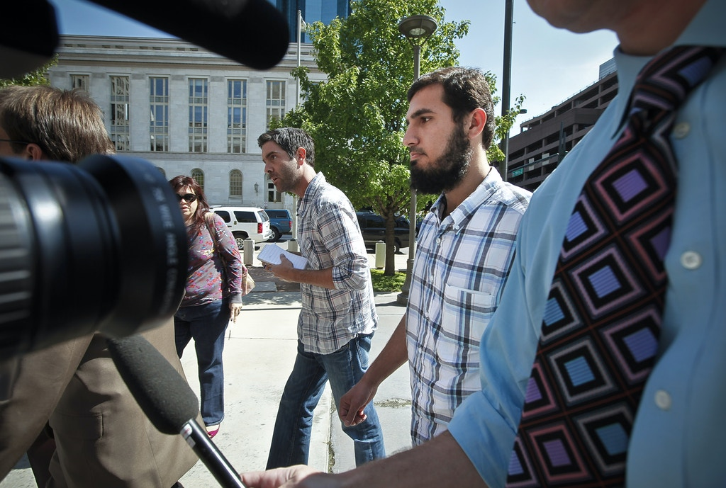 DENVER, COLORADO - SEPTEMEBER 17: Najibullah Zazi (R), 24, arrives at the Byron G. Rogers Federal Building in downtown with his attorney Art Folsom (not pictured) September 17, 2009 in Denver, Colorado. Zazi has been undergoing questioning at the FBI's Denver branch for suspected involvement in a terrorism plot involving peroxide-based explosives. Federal and local authorities searched Zazi's apartment and the home of relatives close by yesterday but have not commented on whether anything was found during the searches. Zazi has repeatedly denied being involved with terrorism or bomb making. (Photo by Marc Piscotty/Getty Images)