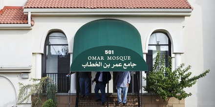 Men walk out of Omar Mosque, the place of worship attended by Sayfullo Saipov, the suspect who drove a truck on a bike path of lower Manhattan, in Paterson, New Jersey on November 03, 2017.