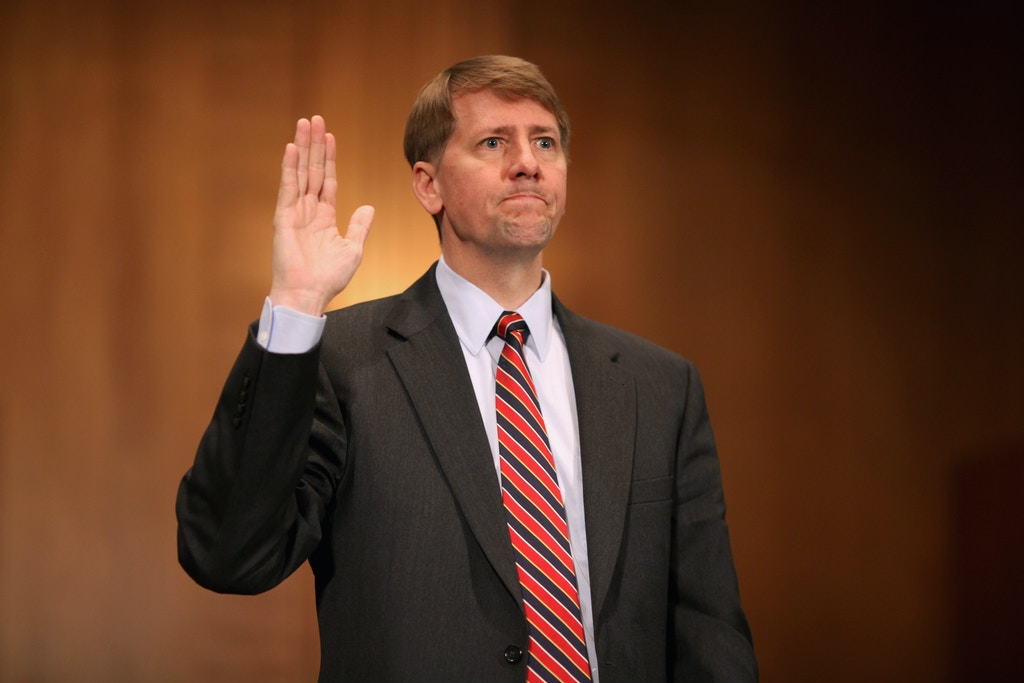 WASHINGTON, DC - SEPTEMBER 06:  Richard Cordray is sworn in at the beginning of his confirmation hearing before the Senate Banking, Housing and Urban Affairs Committee on Capitol Hill September 6, 2011 in Washington, DC. Former Ohio Attorney General Cordray has been nominated by President Barack Obama to be the first director of the United States Consumer Financial Protection Bureau.  (Photo by Chip Somodevilla/Getty Images)