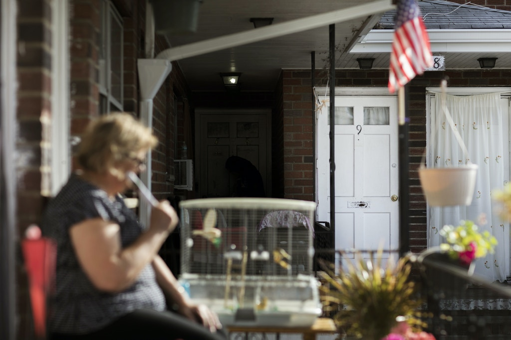 A neighbor of Sayfullo Saipov, the suspect who drove a truck on a bike path of lower Manhattan, sits on her porch across from his apartment (9) in Paterson, New Jersey on November 03, 2017.