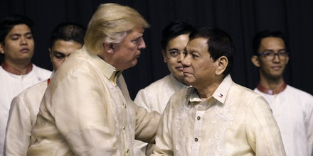 US President Donald Trump shakes hands with Philippines President Rodrigo Duterte during a special gala celebration dinner for the Association of Southeast Asian Nations (ASEAN) in Manila on November 12, 2017.World leaders arrive in the Philippines' capital for two days of summits beginning on November 13. / AFP PHOTO / POOL / ATHIT PERAWONGMETHA (Photo credit should read ATHIT PERAWONGMETHA/AFP/Getty Images)
