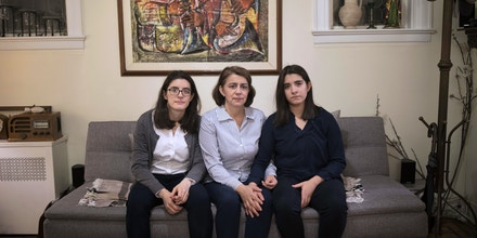 Colombian immigrant Liany Guerrero, center, with her twin daughters Liany Jr. Villacis-Guerrero and Maria Villacis-Guerrero in their home in Woodhaven, New York on Nov. 21, 2017.