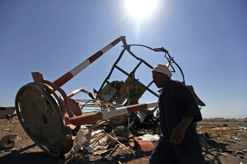 A Yemeni man walks past a navigation station at Sanaa International Airport that was destroyed the previous day in Saudi-led air strikes on the Yemeni capital on November 15, 2017.Authorities in Yemen's rebel-controlled capital said a Saudi-led air strike destroyed a navigation station at Sanaa airport, which is critical to receiving already limited aid shipments. / AFP PHOTO / Mohammed HUWAIS (Photo credit should read MOHAMMED HUWAIS/AFP/Getty Images)