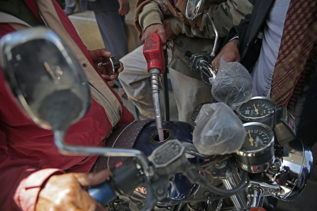 "A Yemeni fills up his motorcycle at a petrol station, amid fuel shortages in Sanaa, Yemen, 09 November 2017. The United Nations has warned that Yemen could face ""the largest famine the world has seen for many decades with millions of victims"" if the Saudi-led military coalition did not allow humanitarian aid access. Photo by: Hani Al-Ansi/picture-alliance/dpa/AP Images"