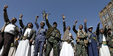Yemenis take part in a demonstration calling for the Saudi-led coalition's blockade to be lifted, on November 13, 2017, in the rebel-held capital Sanaa.The coalition shut down Yemen's borders on November 6 in response to a missile attack by Huthi rebels that was intercepted near Riyadh airport. / AFP PHOTO / MOHAMMED HUWAIS (Photo credit should read MOHAMMED HUWAIS/AFP/Getty Images)