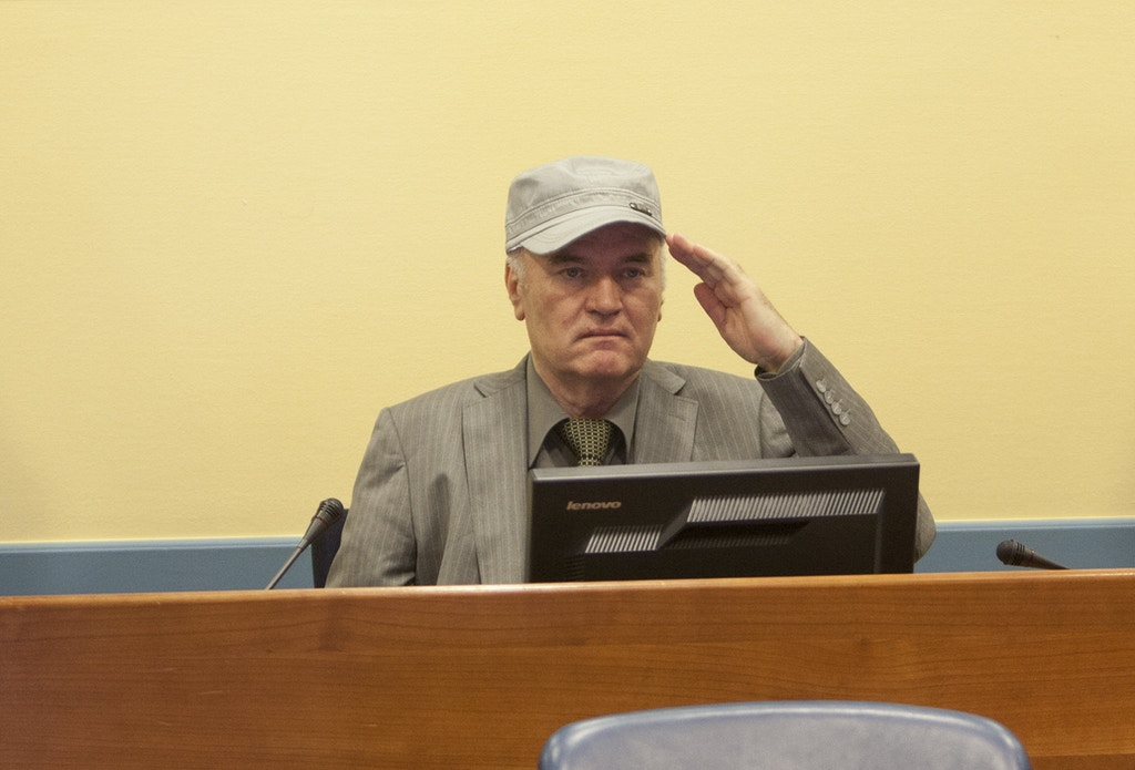 THE HAGUE, NETHERLANDS - JUNE 3: (NETHERLANDS OUT)  Ratko Mladic makes his first appearance at the International Criminal Tribunal on June 3, 2011 in The Hague, Netherlands. Ex-Bosnian Serb army leader Ratko Mladic will make his first appearance at The Hague war crimes tribunal after being declared fit to stand trial. Mladic was arrested a week ago after going into hiding for the past 16 years and is charged with atrocities committed during the Bosnian war. (Photo Serge Ligtenberg/Getty Images )