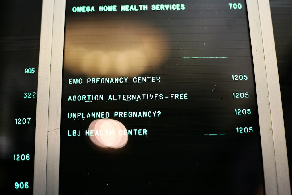 The building directory showing Expectant Mother Care on Court Street in downtown Brooklyn on Thursday, October 28, 2010. (Photo/Emily Berl for the New York Times).