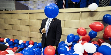 PHILADELPHIA, PA - JULY 28, 2016: A Secret Service agent stands alert amid a plethora of patriotically colored balloons that were released following Hillary Clinton's keynote address as she accepted the democratic presidential nomination at the DNC on July 28, 2016.  (Photo by Benjamin Lowy/Getty Images)
