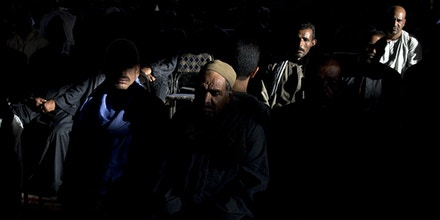 Egyptian men partake in a wake for the victims of a terrorist attack in 'Deir El-Garnouse, near Al-Minya, Egypt, 27 May 2017. 28 coptic Christians died when fighters of the terror militia group Islamic State, or Daesh opened fire on their bus. Photo by: Roger Anis/picture-alliance/dpa/AP Images