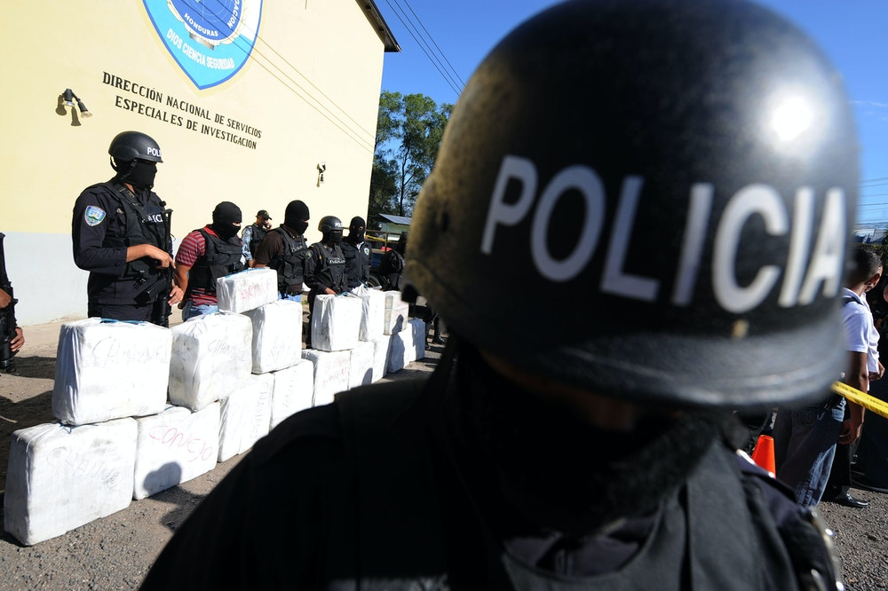 Police officers from the anti-drug squad in Tegucigalpa on October 7, 2010 look after a load of 500 kilos of cocaine seized from traffickers during a joint operation by the Honduran Police, the Army and the US Drug Enforcement Administration (DEA), in Brus Laguna, Mosquitia, Honduras.  AFP PHOTO/Orlando SIERRA (Photo credit should read ORLANDO SIERRA/AFP/Getty Images)