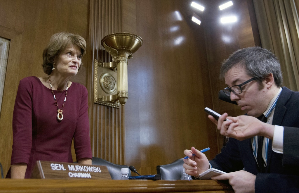 "Senate Energy and Natural Resources Committee Chair Sen. Lisa Murkowski, R-Alaska, speaks with reporters after the Energy and Natural Resources Committee hearing on Capitol Hill in Washington, Wednesday, Nov. 15, 2017, to consider, pursuant to H.Con.Res.71, the Concurrent Resolution on the Budget for Fiscal Year 2018, reconciliation legislation to authorize the Secretary of the Interior to establish and administer a competitive oil and gas program in the non-wilderness portion of the Arctic National Wildlife Refuge, known as the ""1002 Area"" or Coastal Plain. ( AP Photo/Jose Luis Magana)"