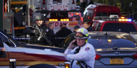 First responders at the scene of an incident along West Street in Lower Manhattan, Oct. 31, 2017. Six people were reported killed and 11 injured when a man drove a pickup truck down a lengthy stretch of bike path; the attacker crashed into a school bus outside Stuyvesant High School then jumped out with two fake guns and was reportedly shot by police officers. (Chang W. Lee/The New York Times)