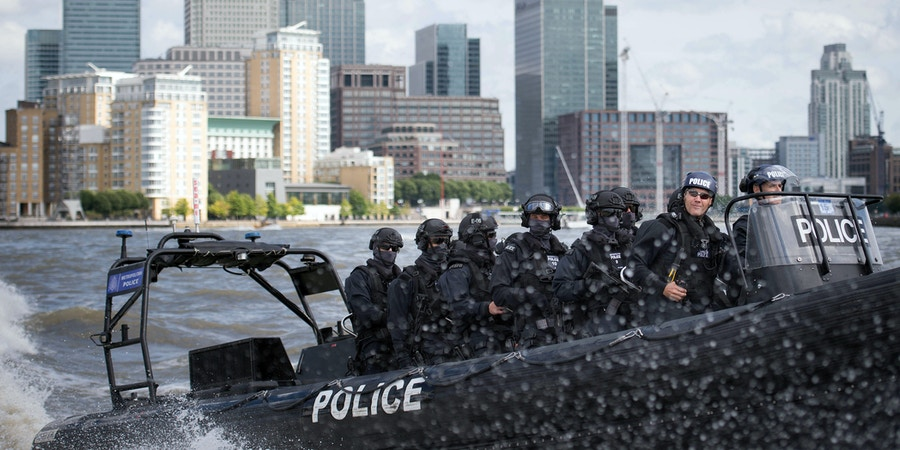 Armed Metropolitan Police counter terrorism officers take part in an exercise on the River Thames in London, Wednesday Aug. 3, 2016. London's police force is putting more armed officers on the streets 'to protect against the threat of terrorism.'' The increase in the number of officers follows attacks in France, Belgium and Germany.  (Stefan Rousseau/Pool Photo via AP)
