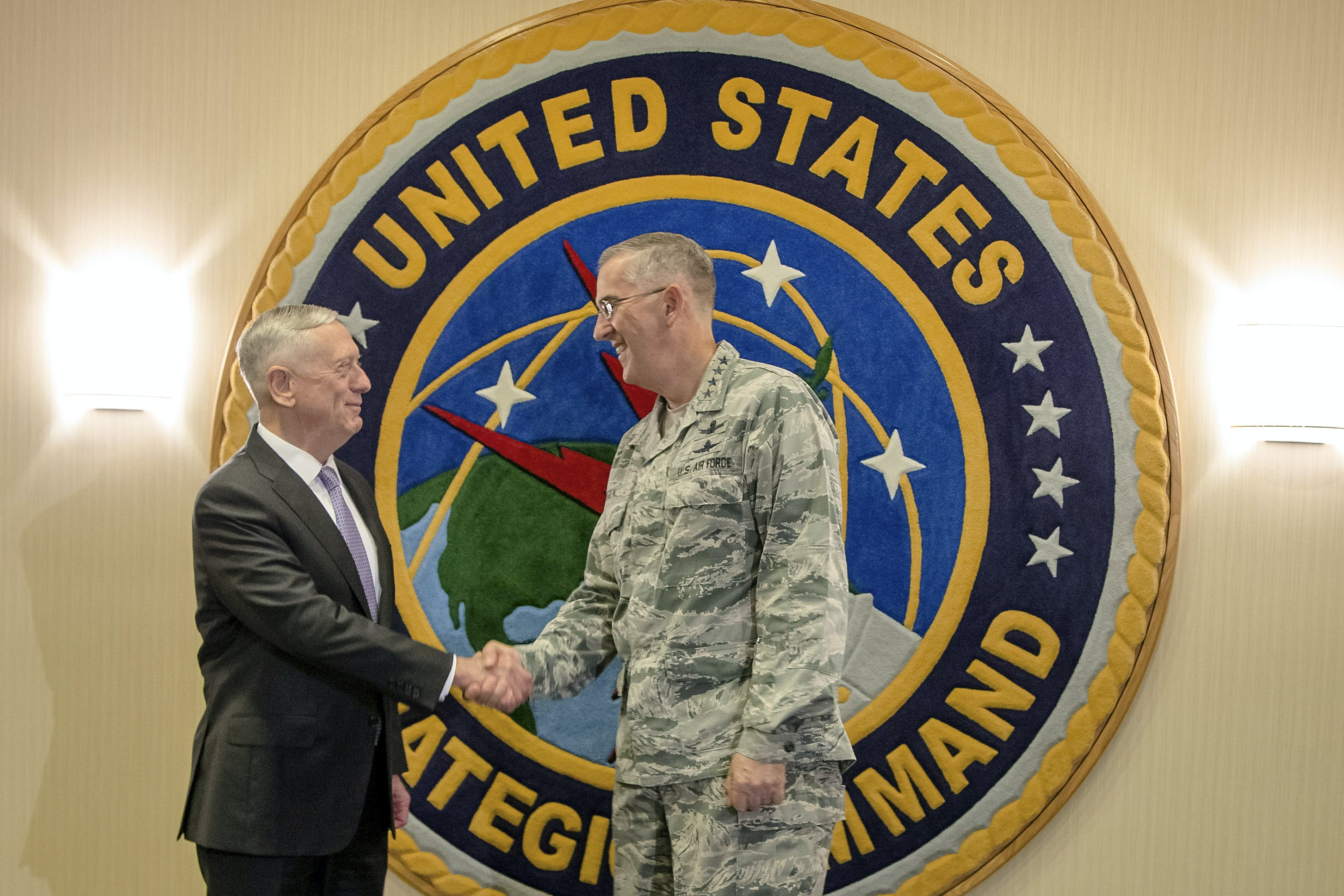 """Secretary of Defense Jim Mattis, left, poses for a handshake at Offutt Air Force Base with Gen. John E. Hyten, the head of Strategic Command, in Bellevue, Neb., Thursday, Sept. 14, 2017. Mattis will be receiving classified briefings at Strategic Command, which will help him in his """"nuclear posture review,"""" a top-to-bottom reassessment of U.S. nuclear weapons policy. (AP Photo/Nati Harnik)"""
