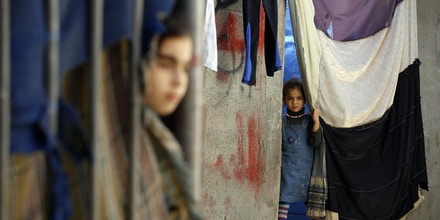 A Palestinian girl stands outside her house at al-shatee refugee camp in Gaza City, on October 30, 2017.Britain's Balfour Declaration turns 100 this week, hailed by Israel for helping lead to its founding, but viewed by Palestinians as contributing to a catastrophe that stole their land. / AFP PHOTO / MOHAMMED ABED (Photo credit should read MOHAMMED ABED/AFP/Getty Images)