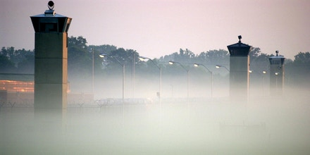 TERRE HAUTE, UNITED STATES:  Guard towers surrounding the Federal Prison in Terre Haute, Indiana where Oklahoma City Federal Building bomber Timothy McVeigh awaits execution rise out of the early morning fog 09 June 2001. McVeigh ordered his attorneys to stop their appeals and will die early 11 June.     AFP PHOTO/Tannen Maury (Photo credit should read TANNEN MAURY/AFP/Getty Images)