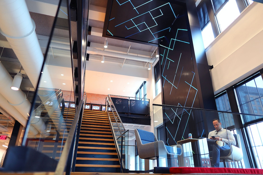 BOSTON, MA - JUNE 27: A staircase with video display is pictured at the new Red Hat computing and executive center in Fort Point in Boston on Jun. 27, 2017. (Photo by John Tlumacki/The Boston Globe via Getty Images)