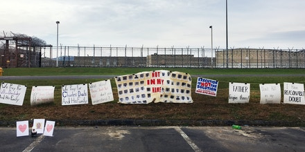Signs hang outside of the Southern Ohio Correctional Institution in reaction to the scheduled execution of Alva Campbell, on November 15, 2017.